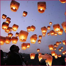 Image of Several Sky Lanterns Being Released at the Same Time