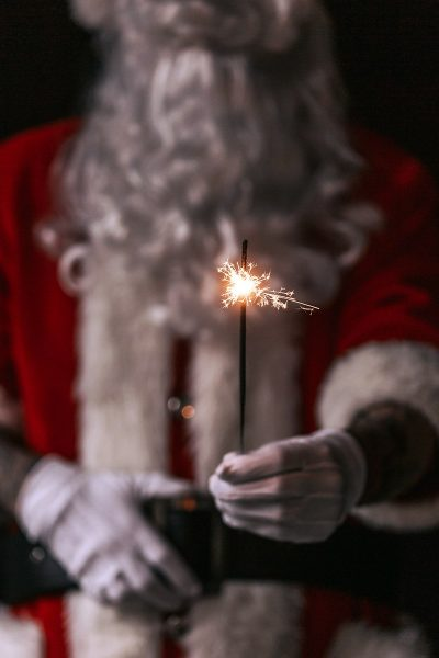 Image of Santa Clause Using Sparklers for Christmas Day