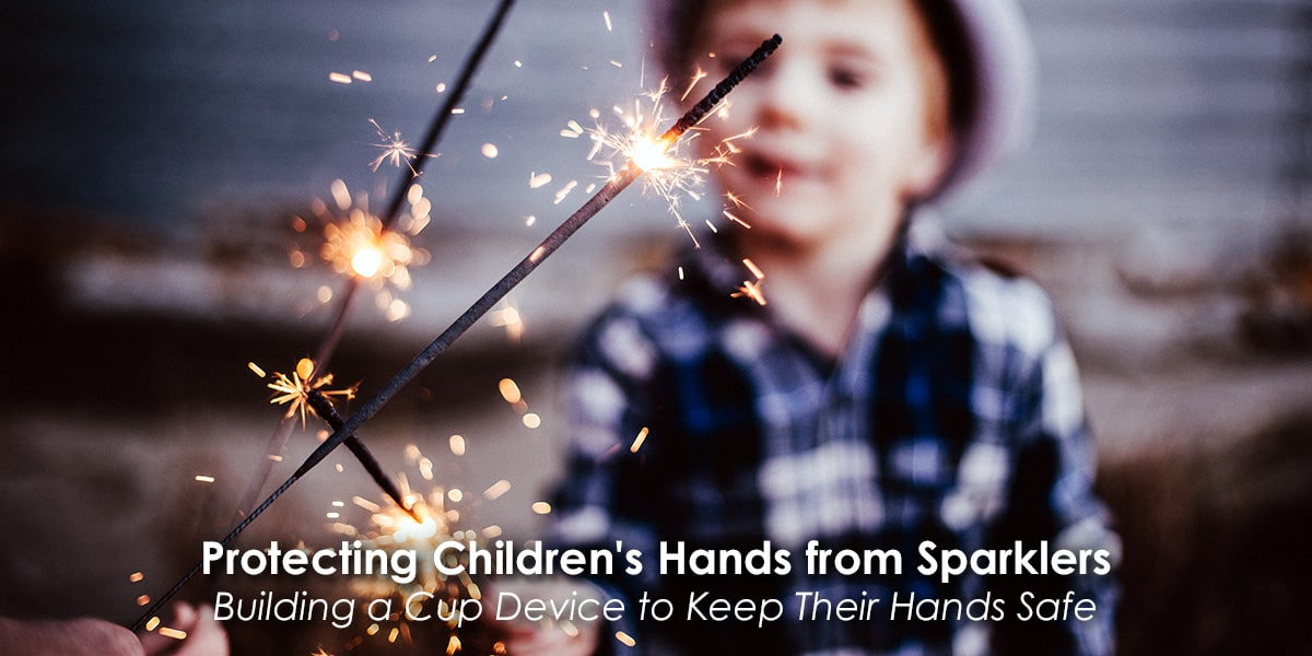 Image of a Parent Protecting Children's Hands from Sparklers