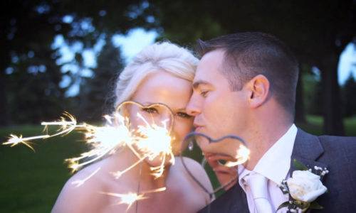 A Couple Holding Heart Shaped Sparklers image