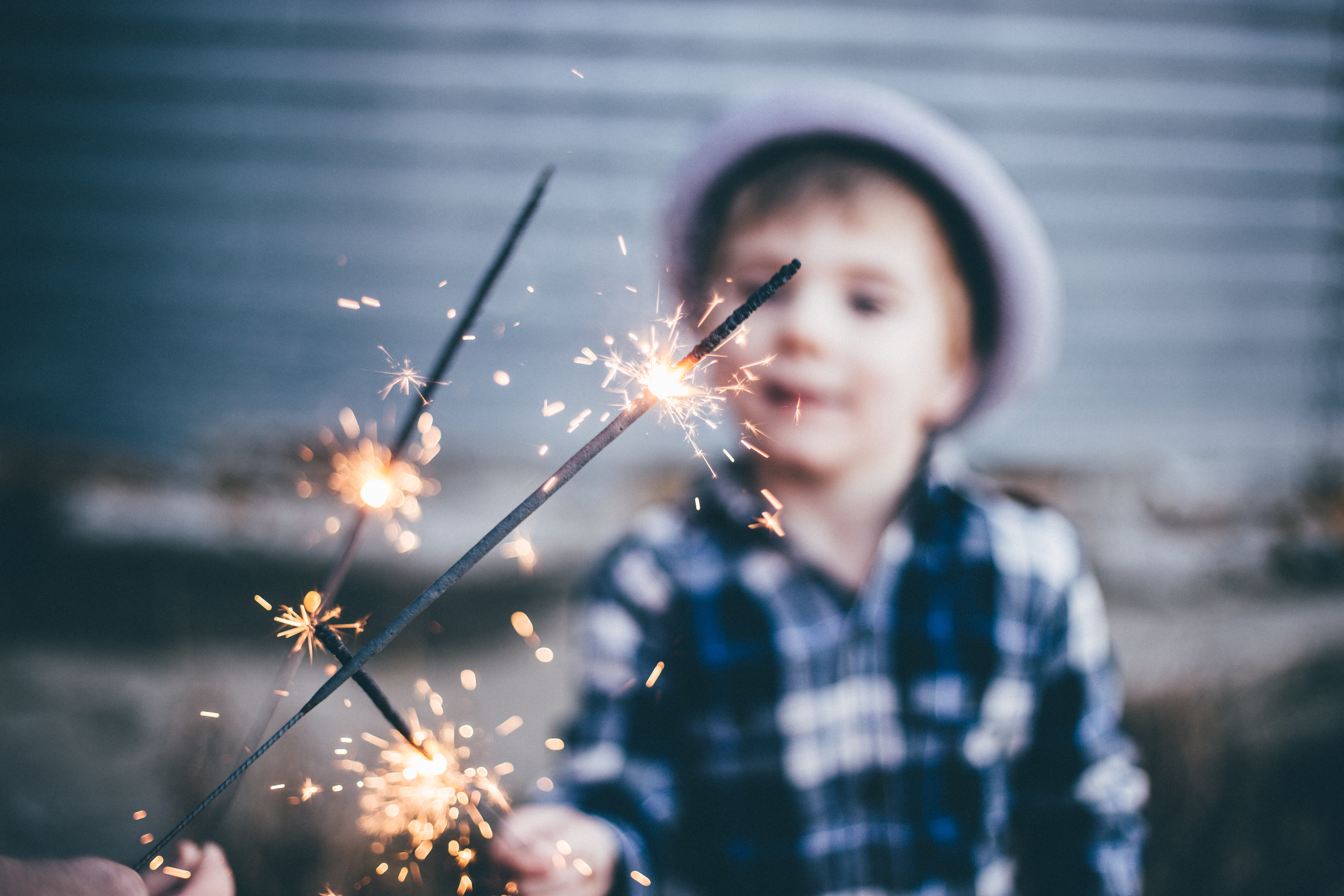 Kid with Neon Colored Sparklers image