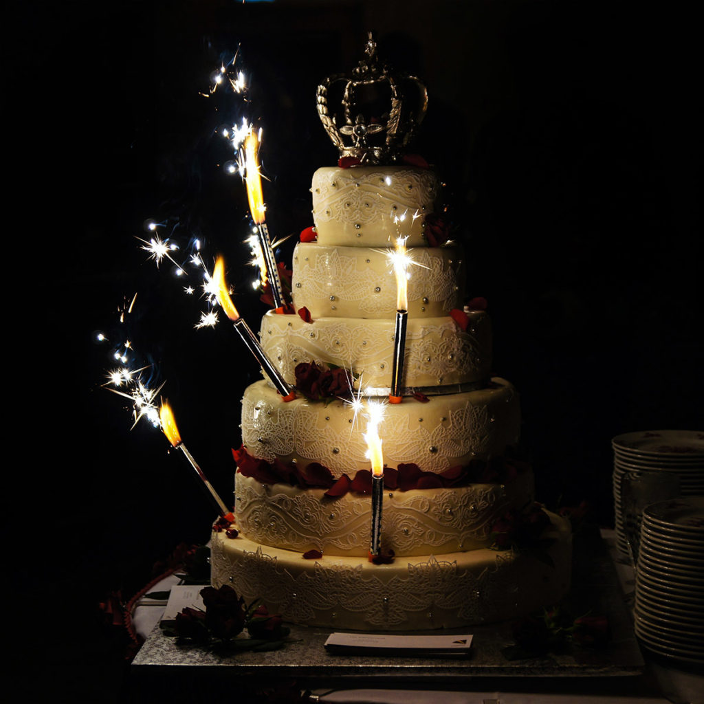 Image of Sparklers on a Wedding Cake in Spring