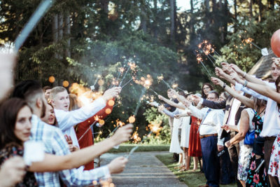 Image of People Using Sparklers at a Wedding Exit