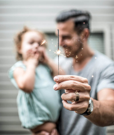 Image of a Father Practicing Good Wedding Sparkler Safety with a Child