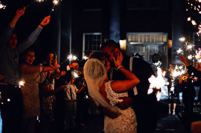 Image of a Couple in an Organized Sparkler Exit