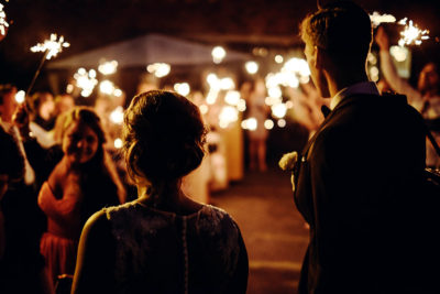 Image of a Couple Being Surprised By Sparklers During their Exit
