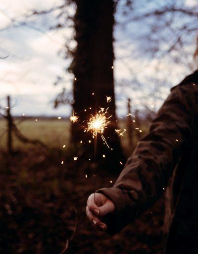 Image of an Adult Lighting a Sparkler