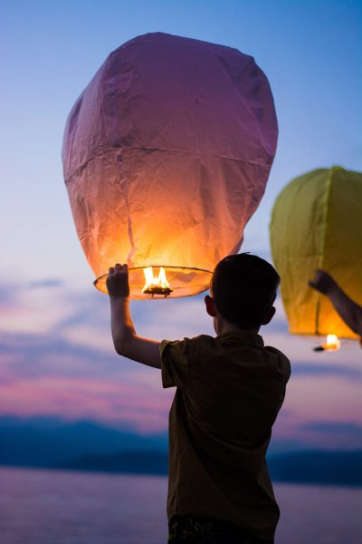 Image of Kids Helping with Sky Lanterns at a Beach Wedding