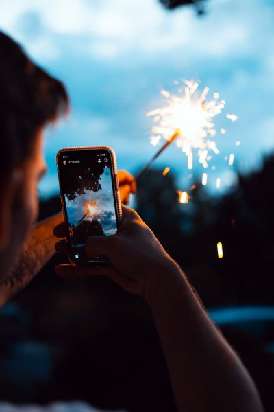 Image of a Man Taking a Candid Photo with a Sparkler