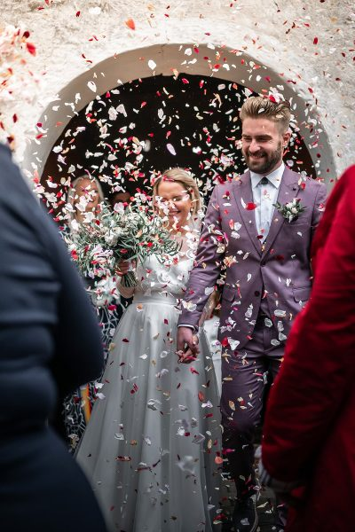 Image of a Couple Using Confetti During a Wedding Exit
