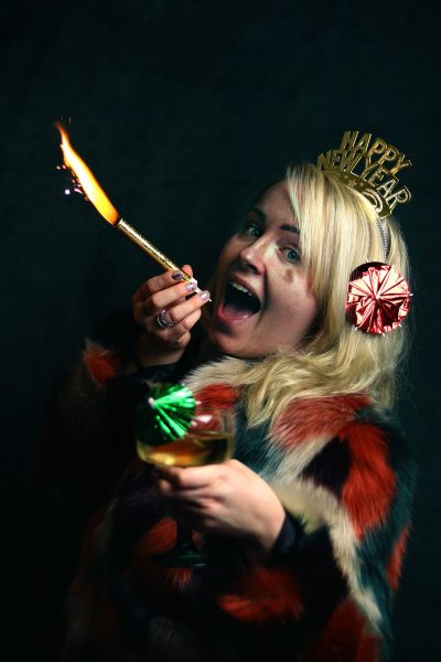 Image of a Woman Putting a Sparkler in Her Mouth