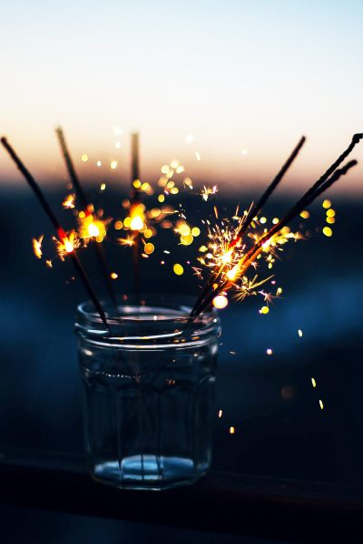Image of Lit Sparklers in a Centerpiece Jar