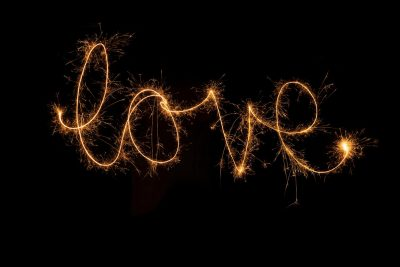 """Image of People Writing the Word """"LOVE"""" With Sparklers"""