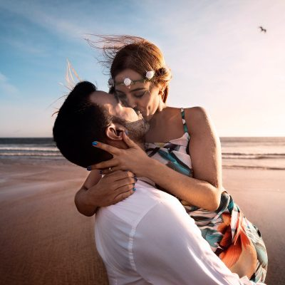 Image of a Couple Kissing at a Wedding on a Windy Beach