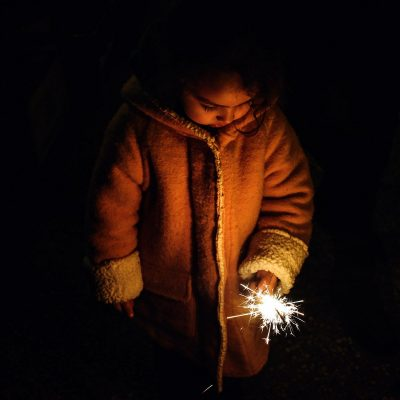 Image of a Child Using a Sparkler Outdoors