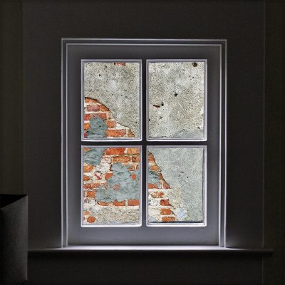 Image of a Window View of a Brick Wall