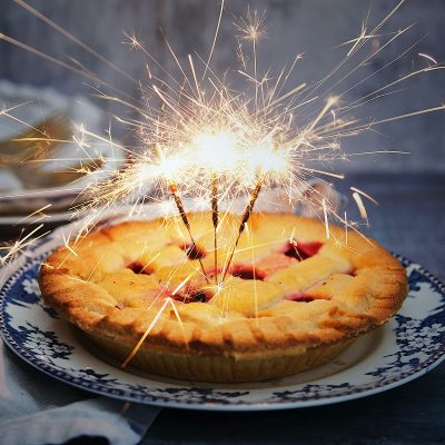 Image of a Family Using Sparklers on a Holiday Pie