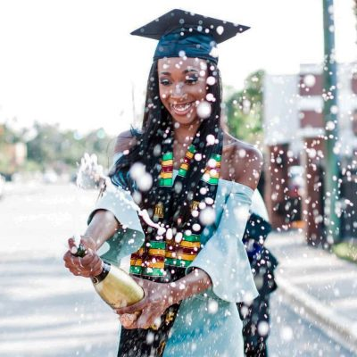 Image of a Woman Celebrating a Graduation with Champagne