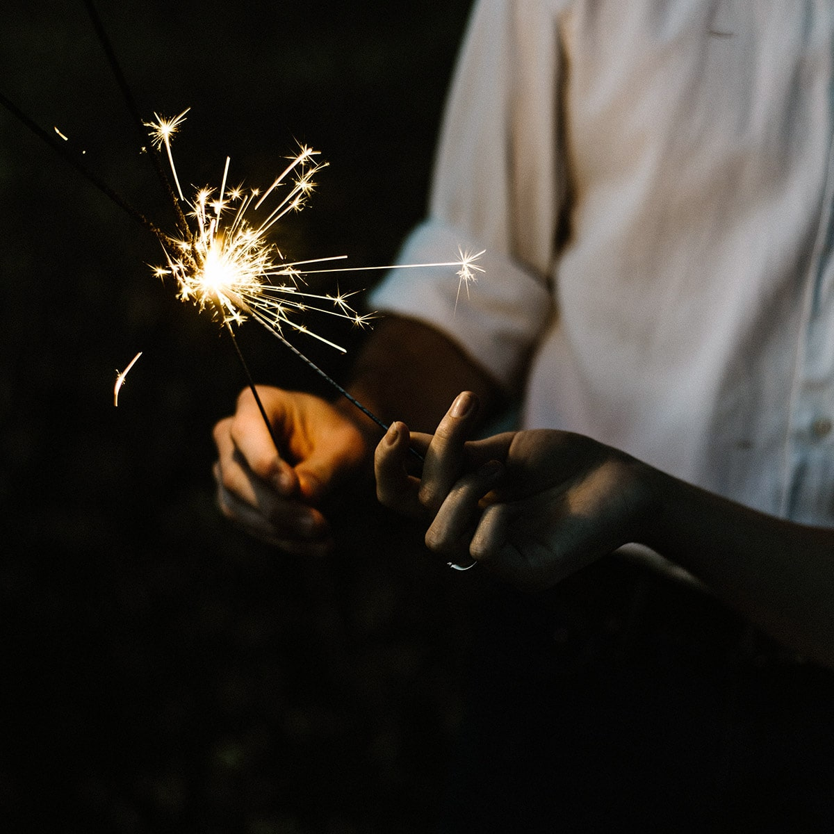 Image of a Couple Lighting Sparklers Before Their Grand Exit