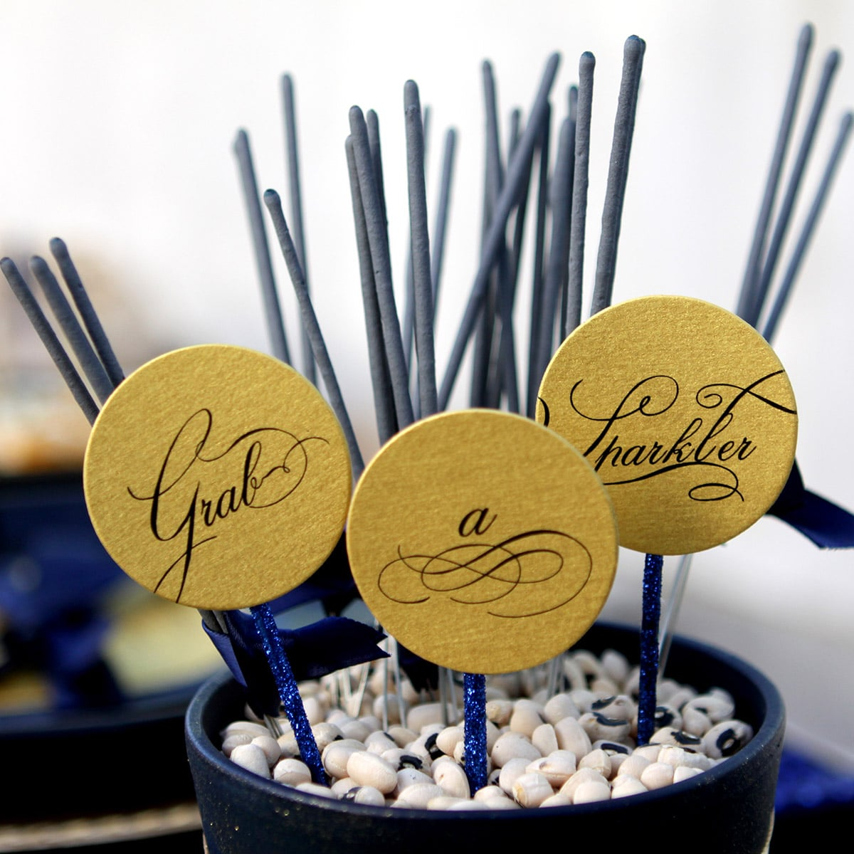 Image of an Elegant Centerpiece with Wooden Signs and Sparklers