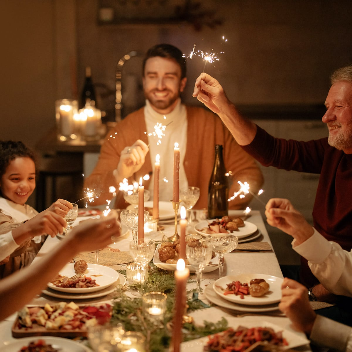 Image of a Family Enjoying Sparklers at Thanksgiving Dinner