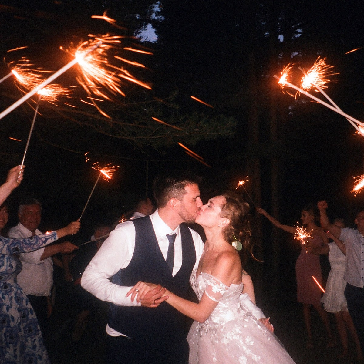 Image of a Couple Kissing Under the Sparkles