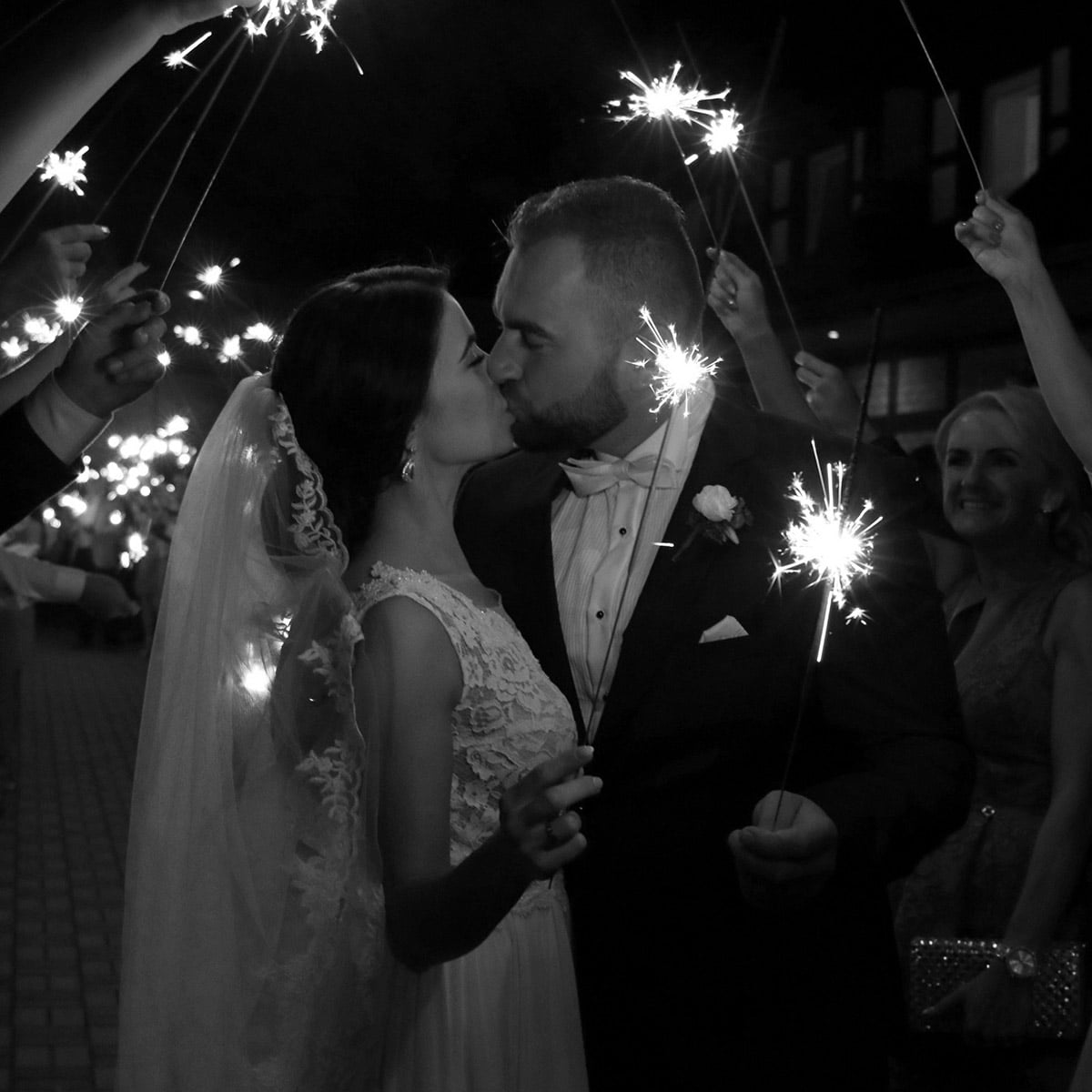 Image of a Romantic Kiss During the Sparkler Exit