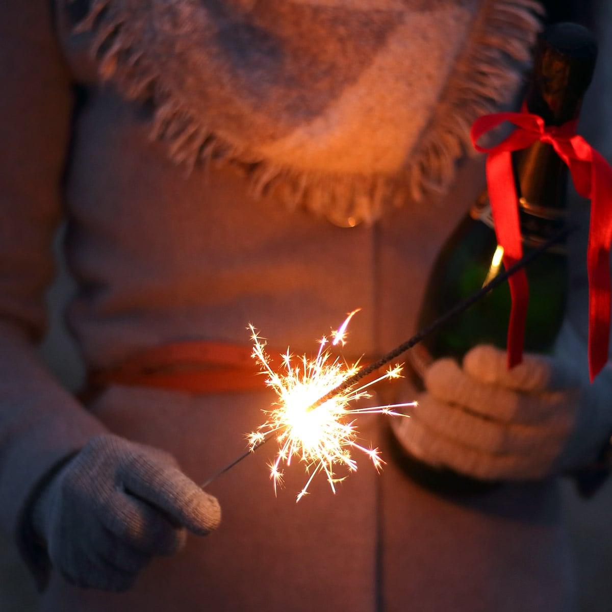 Image of a Woman Sparklers Outside on New Year's Eve