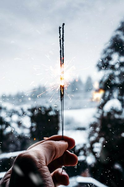 Image of a Man Lighting a Sparkler in the Winter
