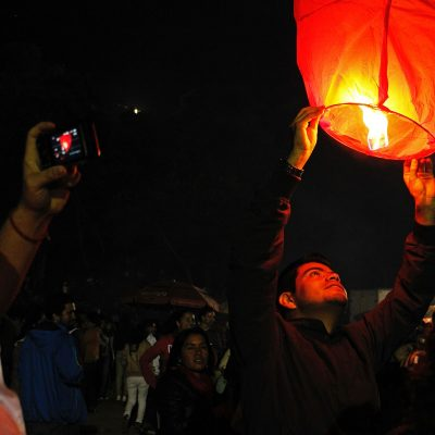 Image of Guests Crowdsourcing Sky Lantern Photos at a Wedding