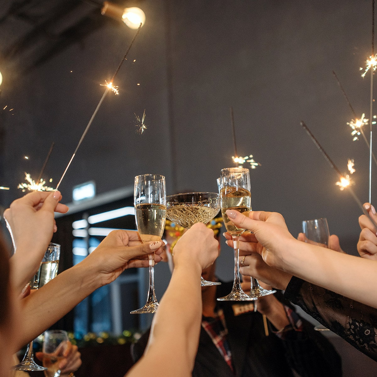 Image of People Using Sparklers at a Party or Event