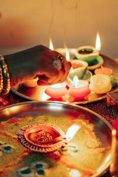 Image of a Woman Lighting Diya for Deepavali