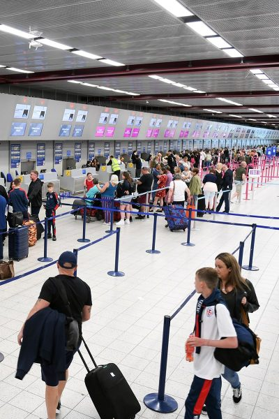 Image of People in Line at an Airport Bagge Check