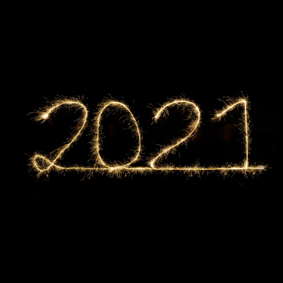 """Image of a Person Writing """"2021"""" in the Air"""