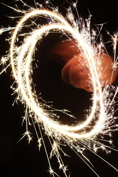 Image of Wedding Guests Making Circle Shapes with Sparklers