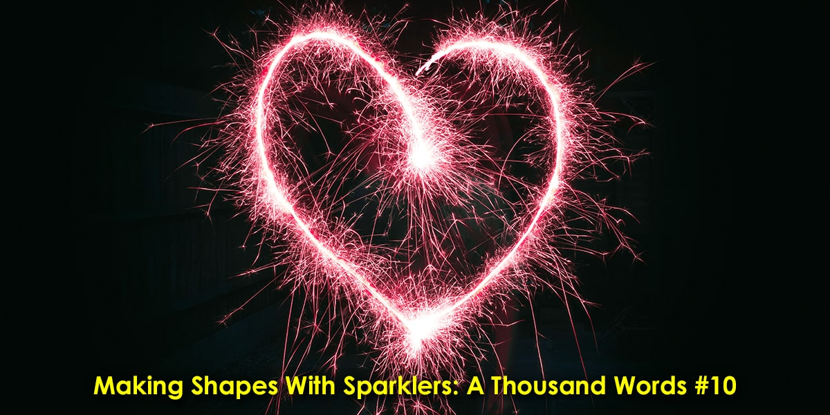 Image of People Making Shapes with Sparklers