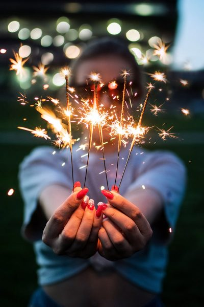 Image of Person Posing with Sparklers for a Picture