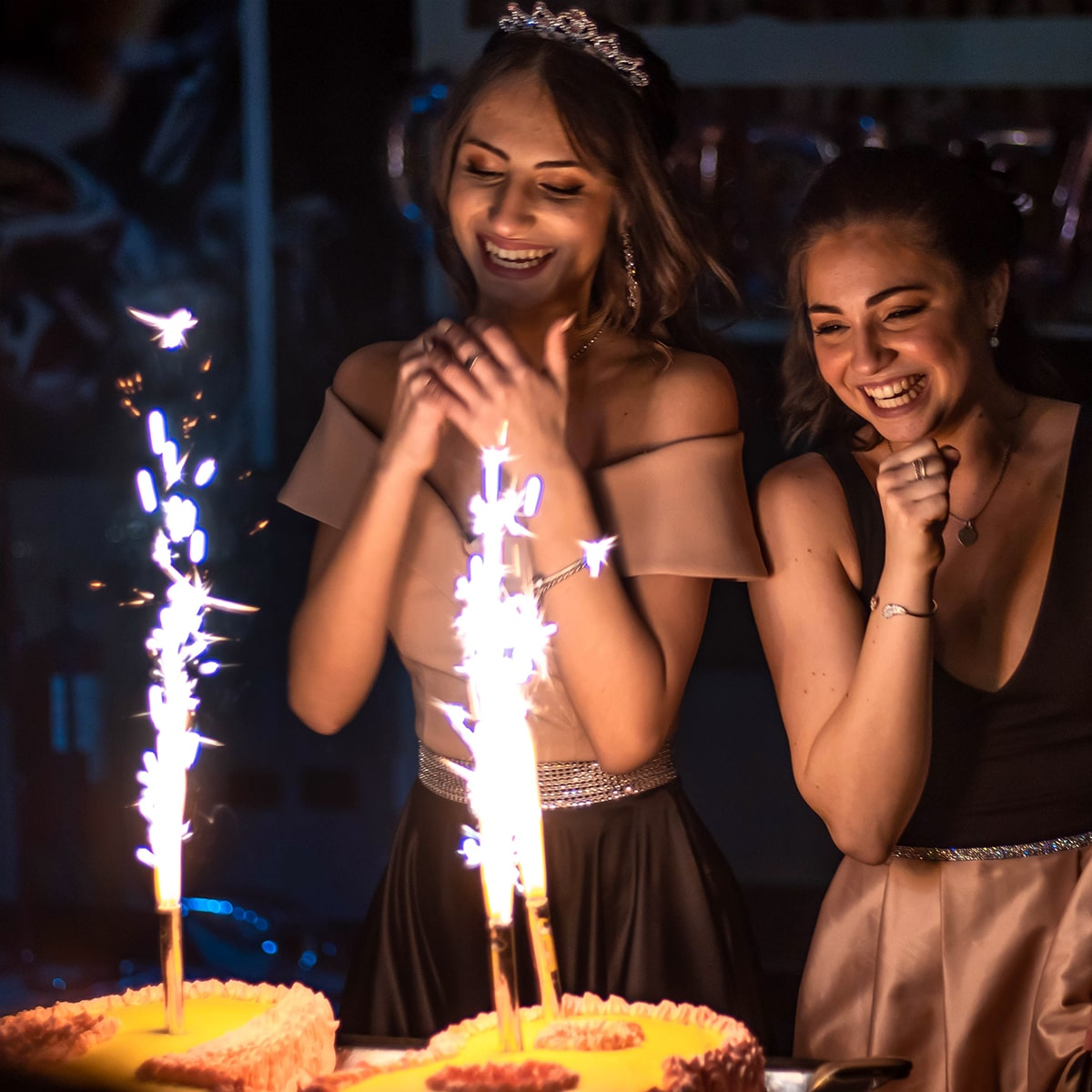 Image of Girls USing Sparklers After the Prom Event
