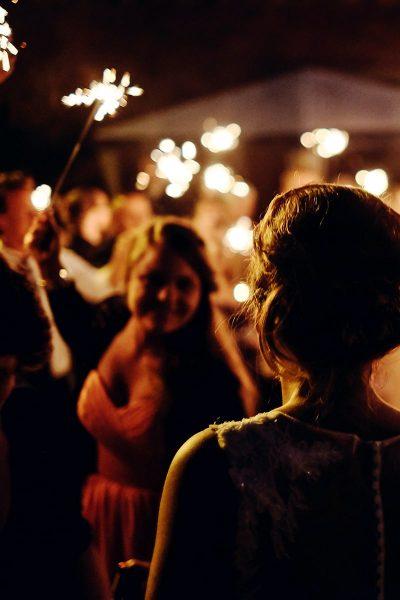 Image og People Safely USing Sparklers at a Wedding Outdoors