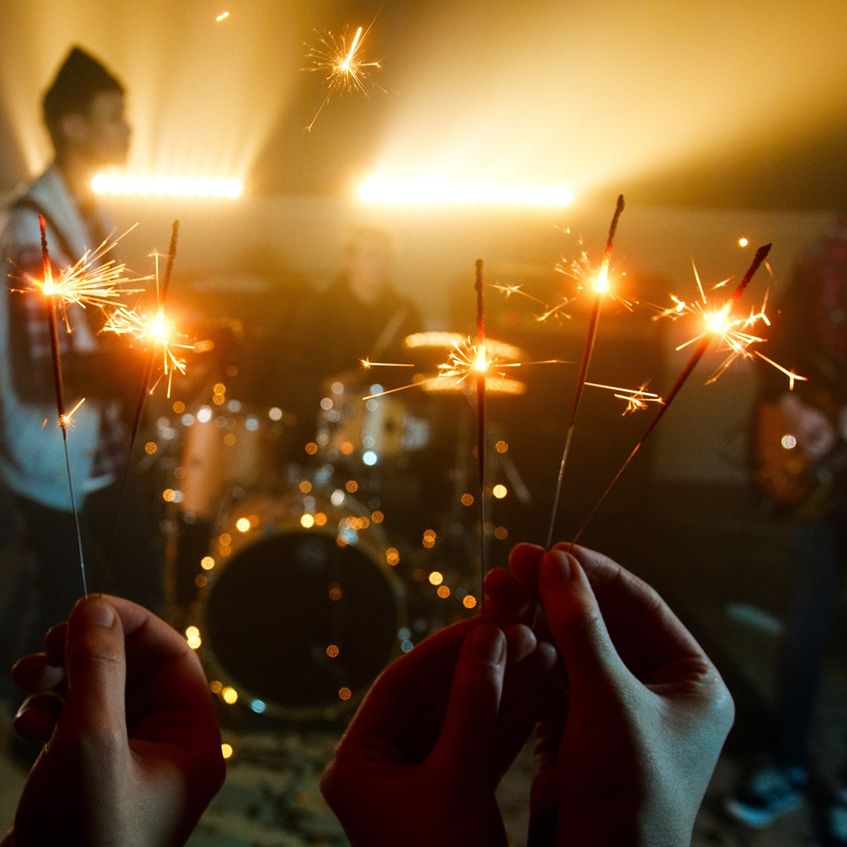 Image of People Using Sparklers at a Live Music Event