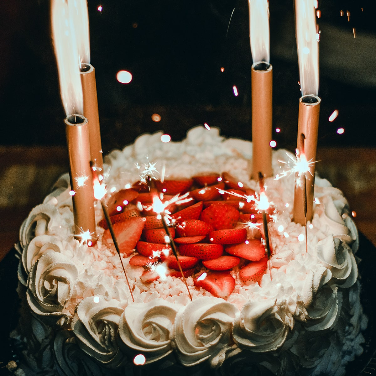 Image of an Anniversary Cake with Sparklers on Top