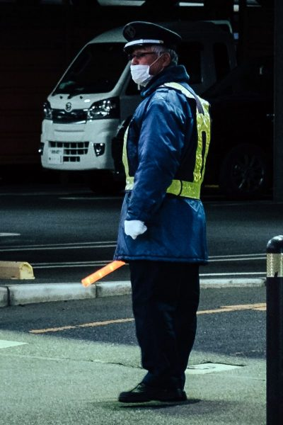 Image of Parking Attendant with and LED Wand